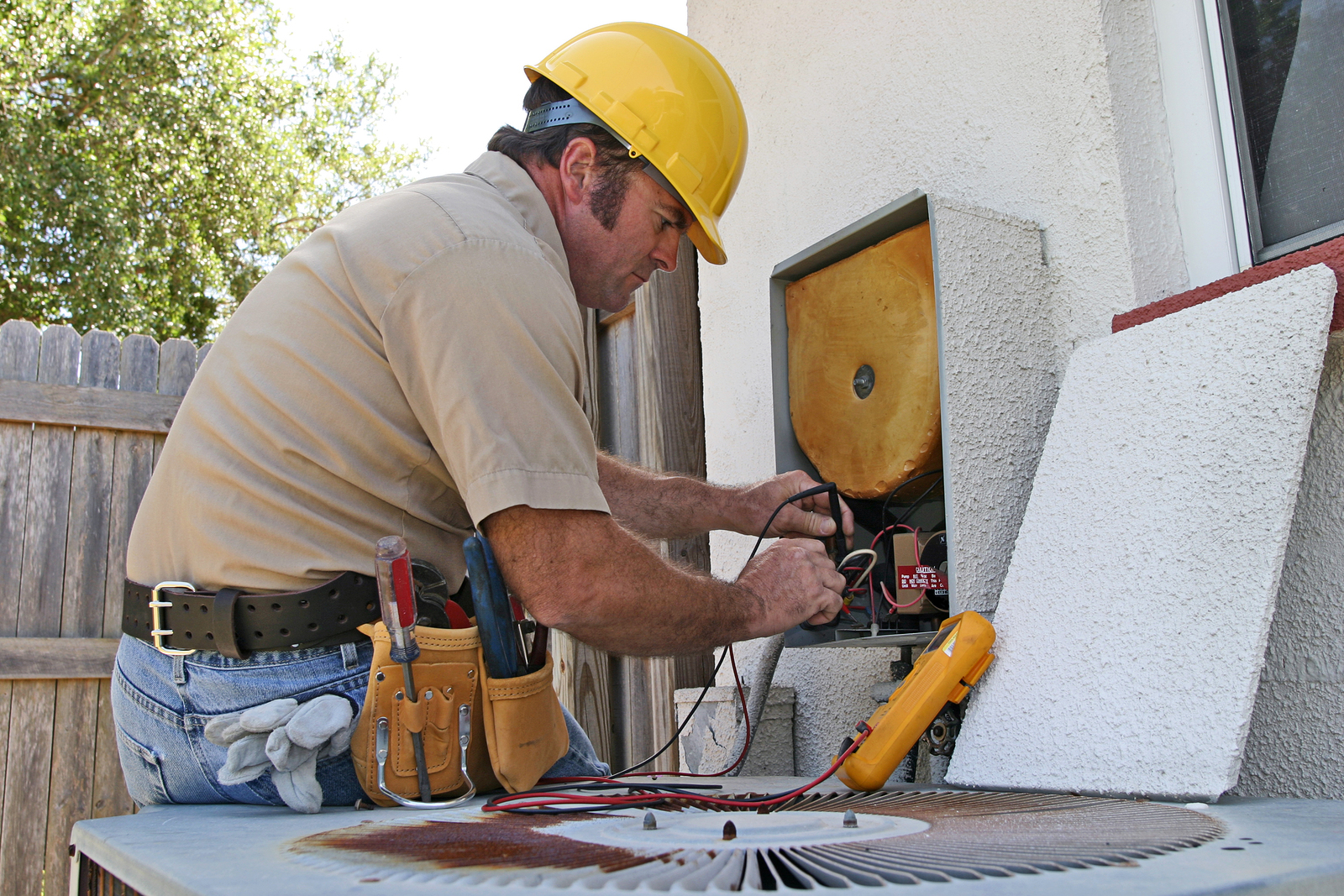 an air conditioning repairman working on a heat recovery unit.